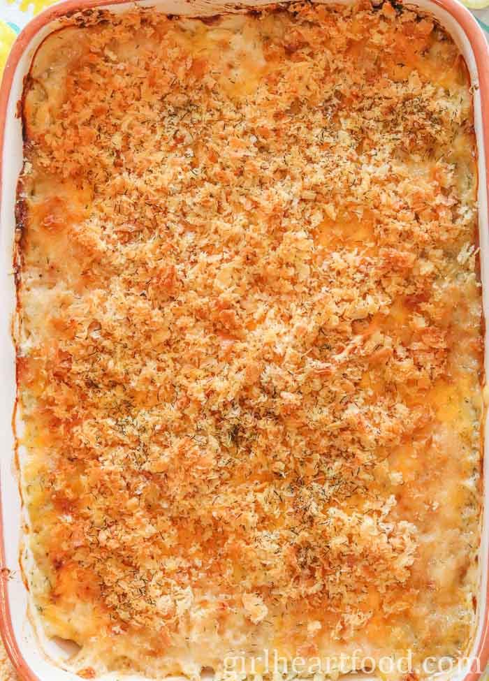 Large rectangular pan of baked cod au gratin.