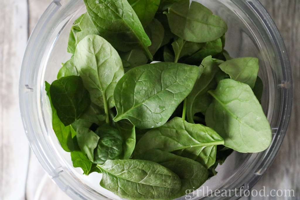 Fresh baby spinach in a food processor.