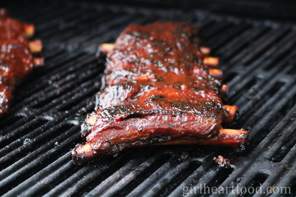 Delicious pork ribs covered in bbq sauce and grilled.