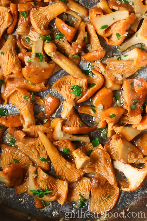 Chanterelle mushrooms being sauteed in butter.