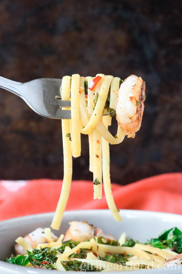 A forkful of chili shrimp pasta.