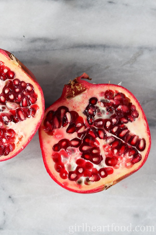 An overhead shot of a pomegranate cut in half.