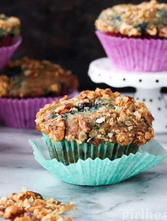 Fluffy and Delicious blueberry muffins with an orange pecan crumble.