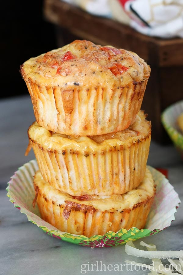 Three Breakfast Ham and Egg Muffins stacked on top of each other.