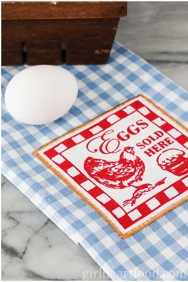 A whole egg on a tea towel
