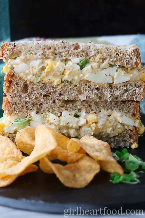Classic Egg Salad Sandwich with potato chips.