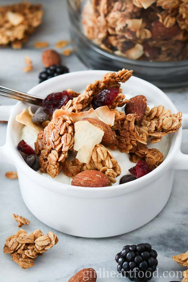 Small bowl of Homemade Granola on top of yogurt