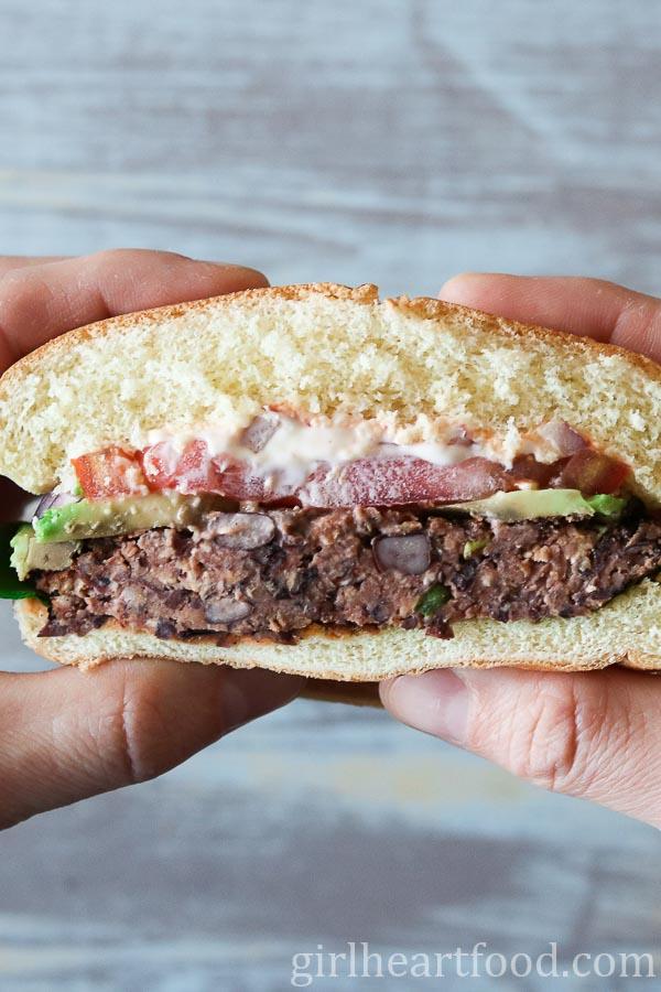 A vegan bean burger cut in half to show interior.