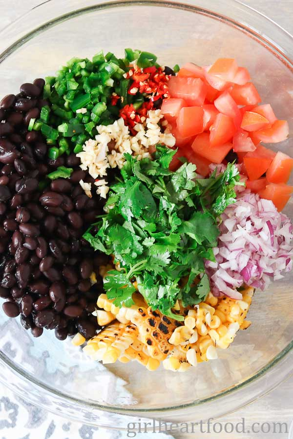 Ingredients for black bean corn salsa in a bowl not yet mixed up.