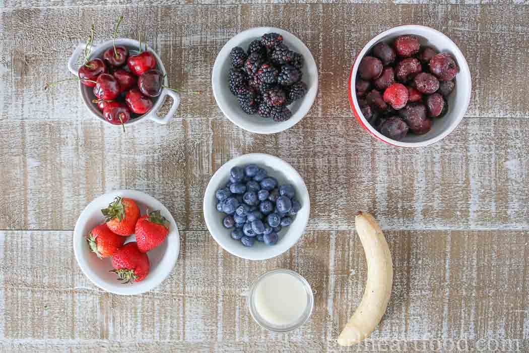 Ingredients for a cherry smoothie bowl.
