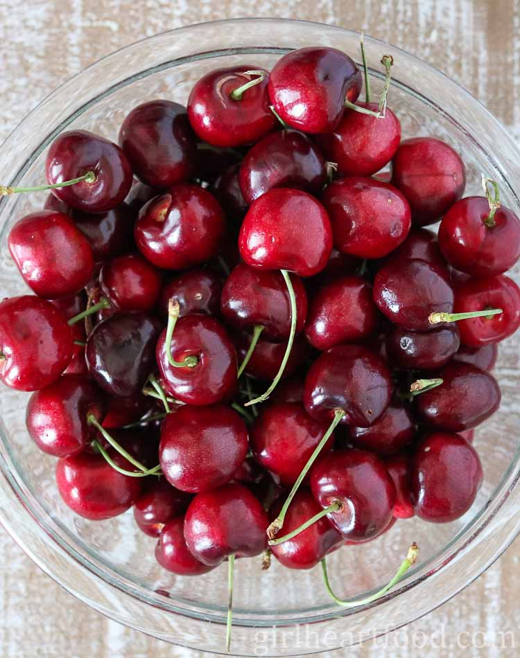 A large bowl of fresh cherries.