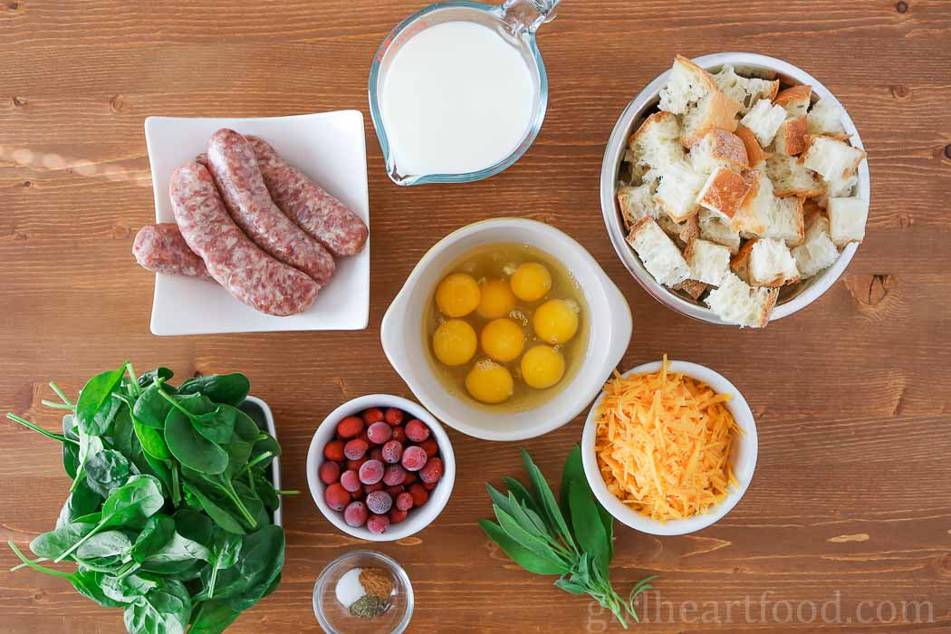 Ingredients for a strata recipe on a wooden board.