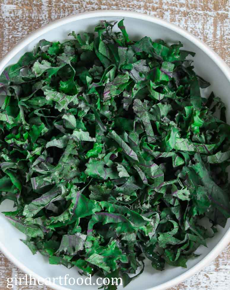 A bowl of chopped raw kale.