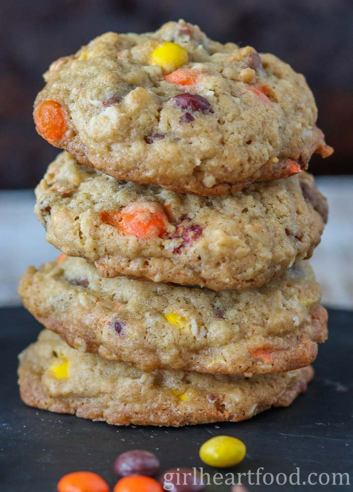 Stack of Reese's cookies alongside some candy.