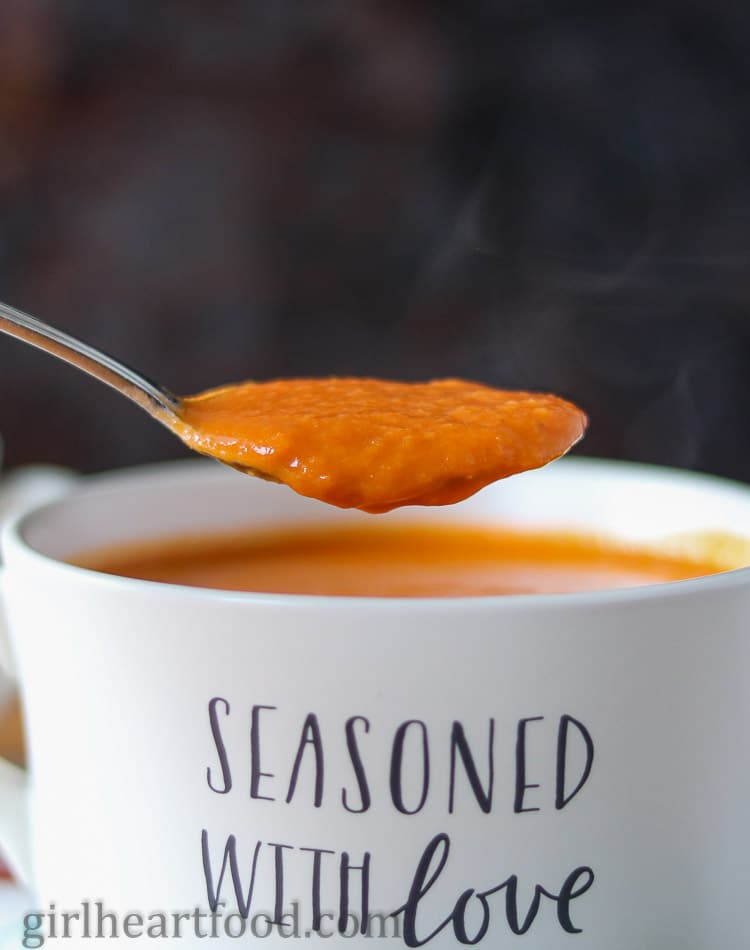 A spoonful of roasted red pepper, tomato and fennel soup.