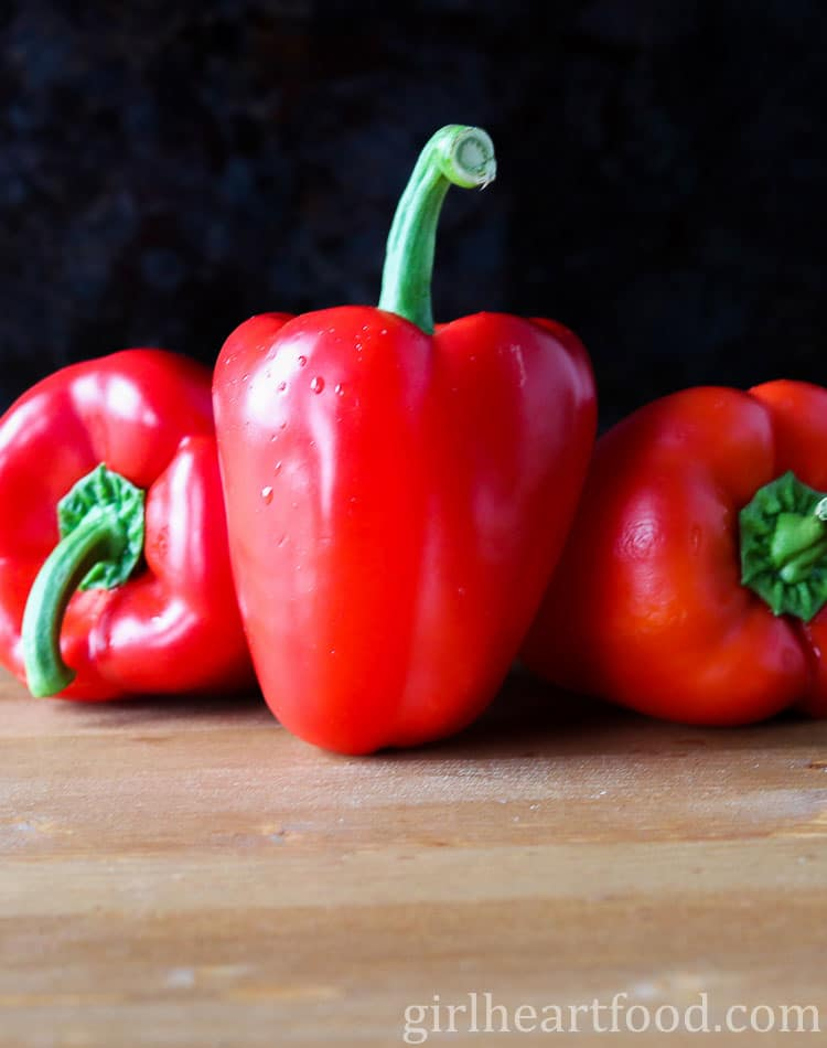 A photo of three red peppers.