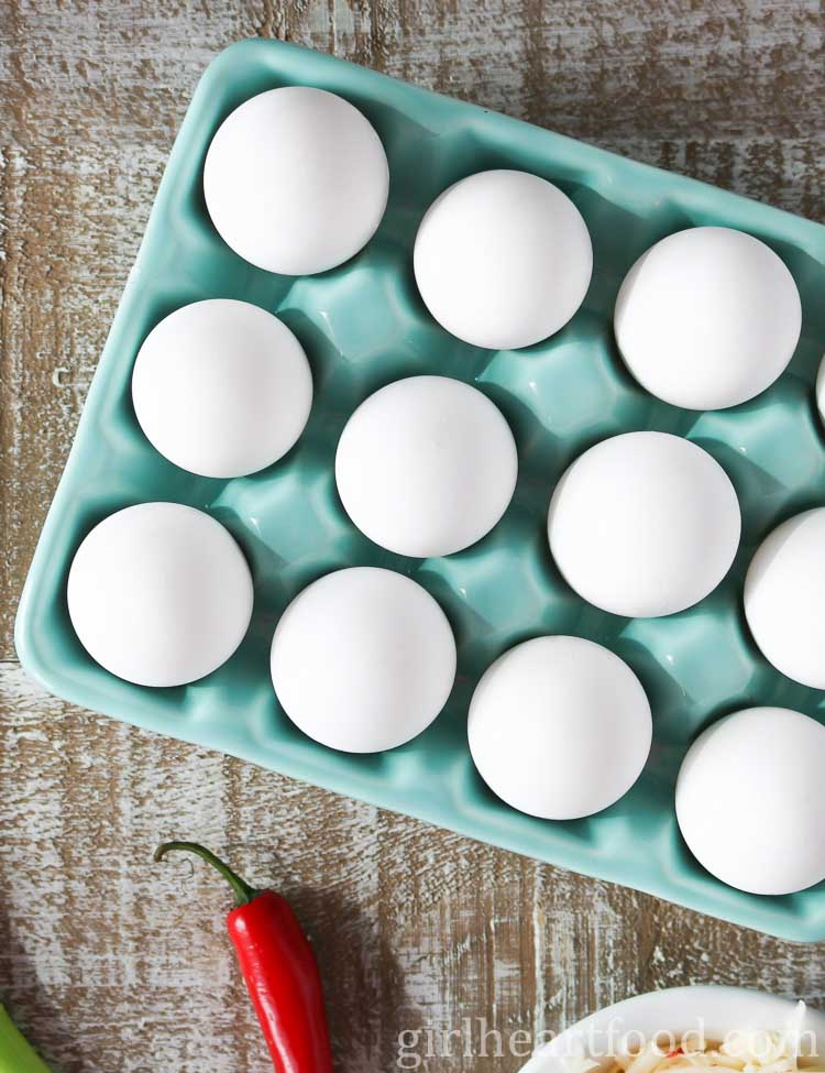 Overhead shot of eggs in a glass dish.