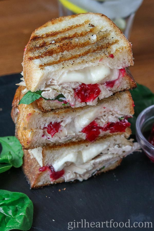 Stack of grilled turkey sandwich with cranberry and cheese.
