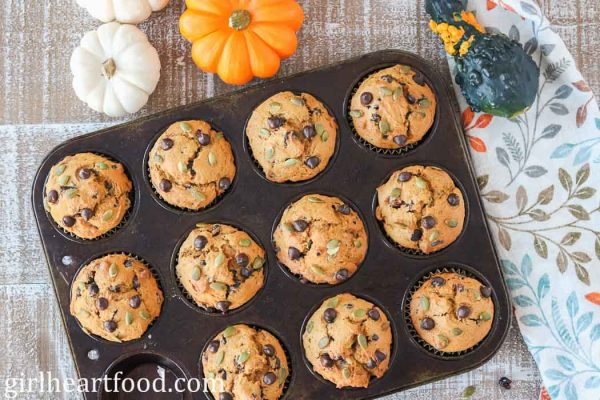 A pan of pumpkin chocolate chip muffins.