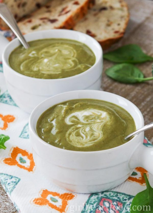 Two bowls of vegan broccoli soup with spinach.