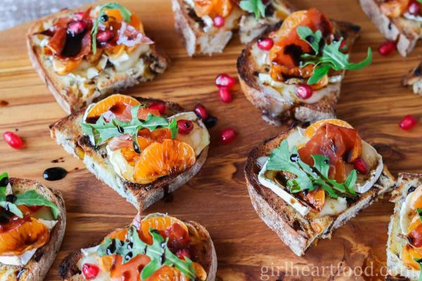 Christmas crostini on a wooden board.