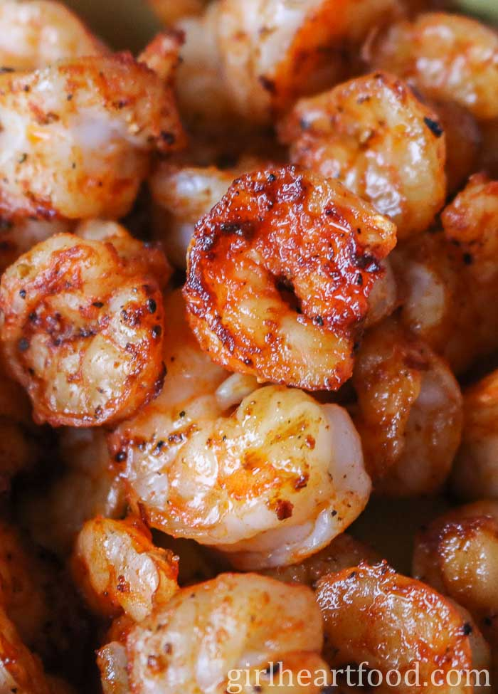 Close-up of cooked spiced coated shrimp.