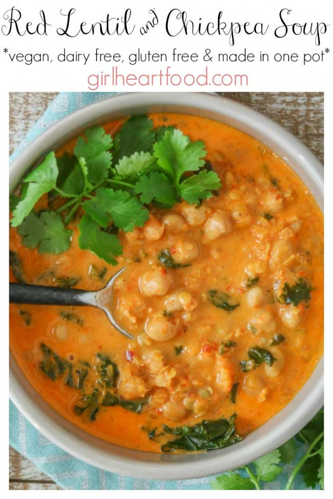 Bowl of red lentil chickpea soup garnished with cilantro and a spoon resting in the soup.