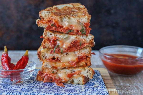 An easy grilled cheese sandwich stacked high alongside pizza sauce and chili.