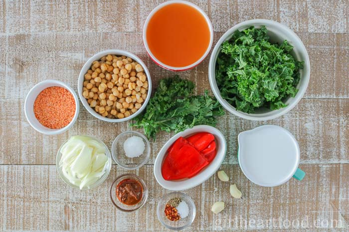 Ingredients for an easy red lentil soup recipe with chickpeas and kale.