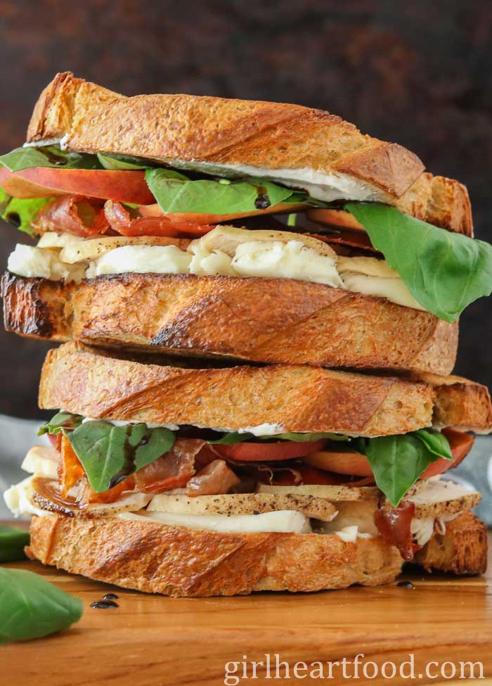 Two chicken and prosciutto sandwiches stacked on top of each other.