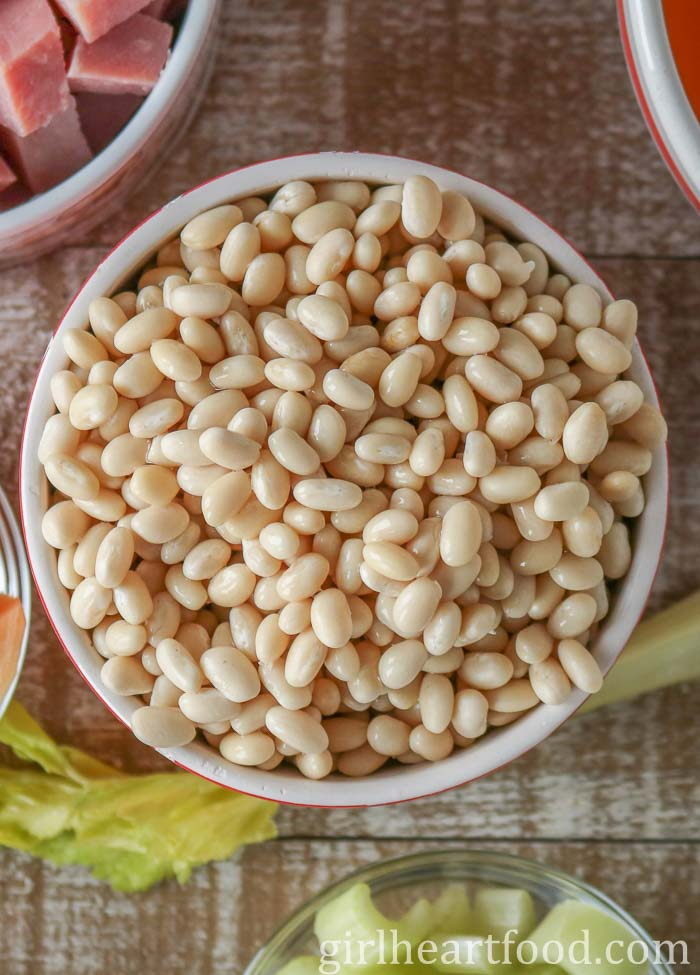 An overhead shot of a bowl of white beans.