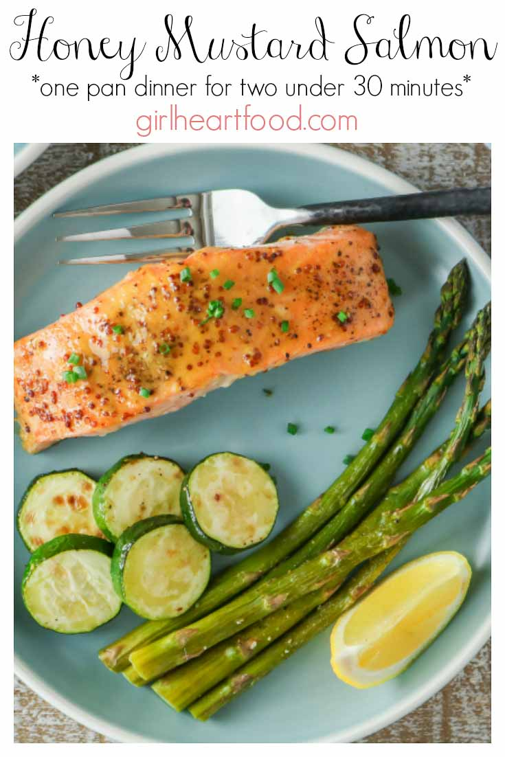 Honey mustard salmon fillet with vegetables on a blue plate.