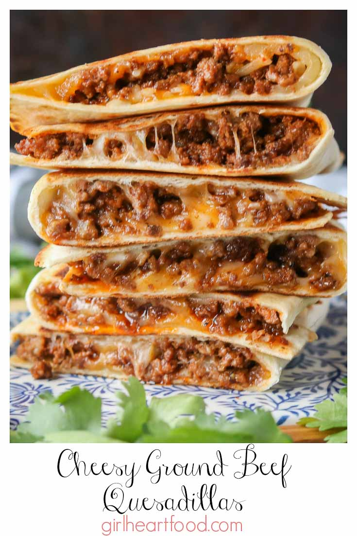 Tall stack of cheesy quesadillas made with ground beef.