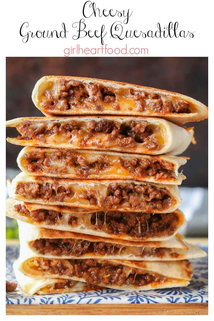 Tall stack of crispy ground beef quesadillas with cheese.
