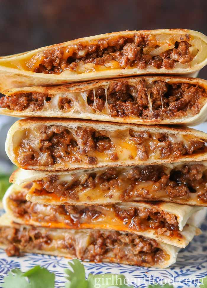 A tall stack of beef and cheese quesadillas.