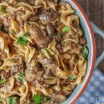 Large dish of an easy ground beef stroganoff recipe garnished with fresh parsley.