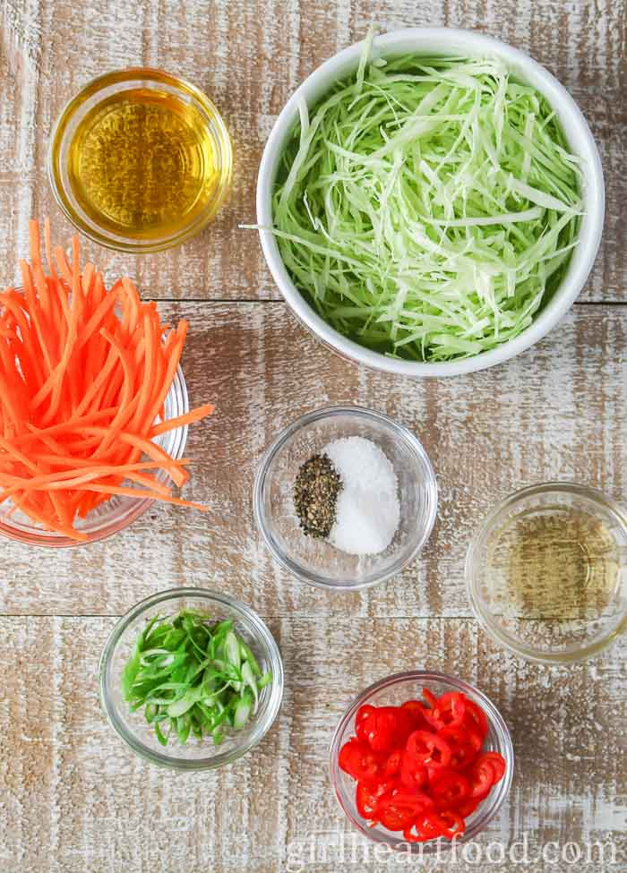 Ingredients for an easy coleslaw recipe on a wooden board.