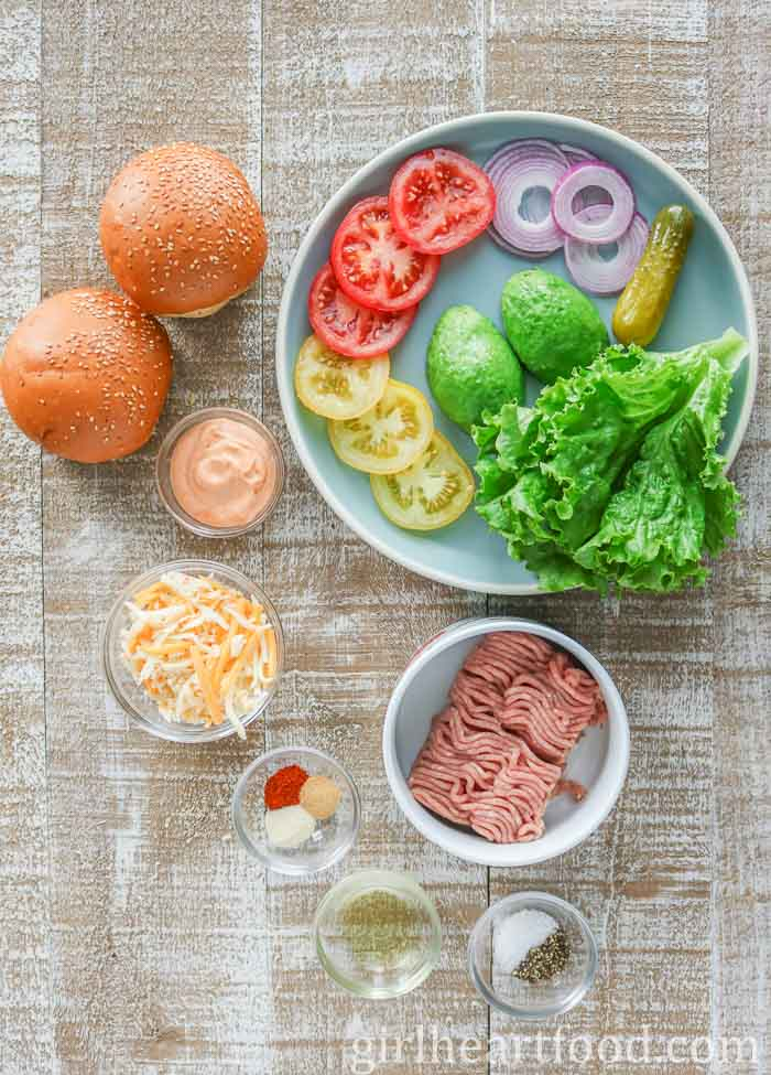 Ingredients for an easy turkey burger recipe on a wooden board.