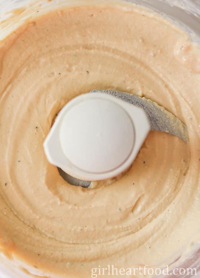 Creamy hummus in a food processor.