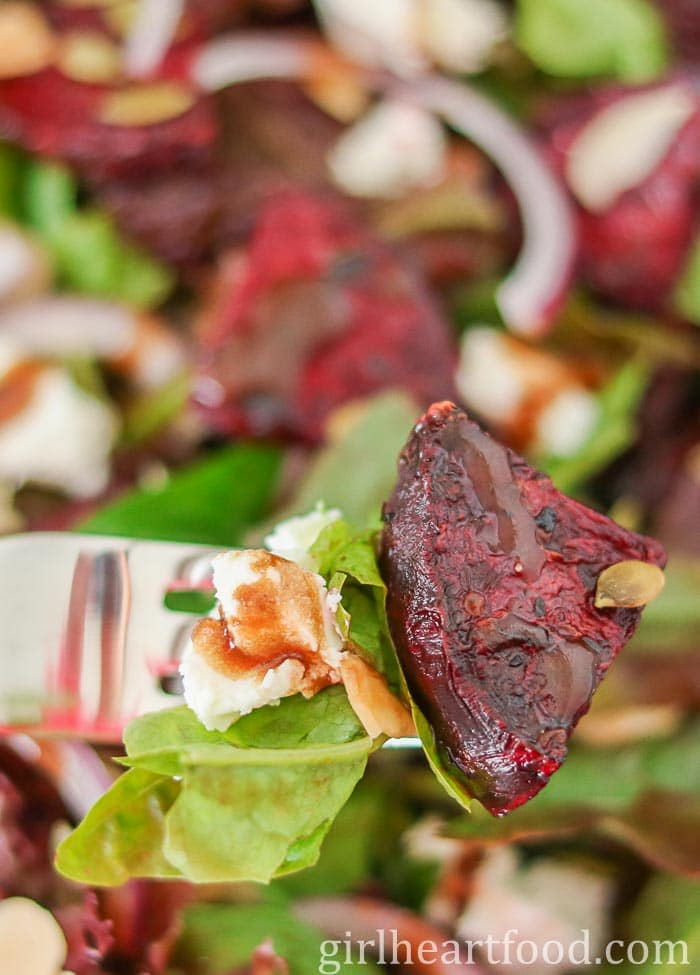Forkful of roasted beet and goat cheese salad.
