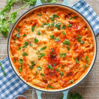 Pan of turkey noodle casserole topped with fresh parsley.