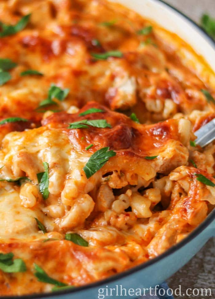 Pan of turkey pasta casserole with a spoon dunked into the pasta.