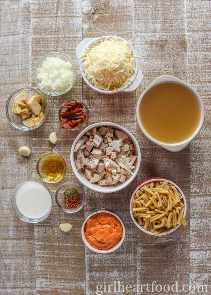 Ingredients for leftover turkey pasta on a wooden board.