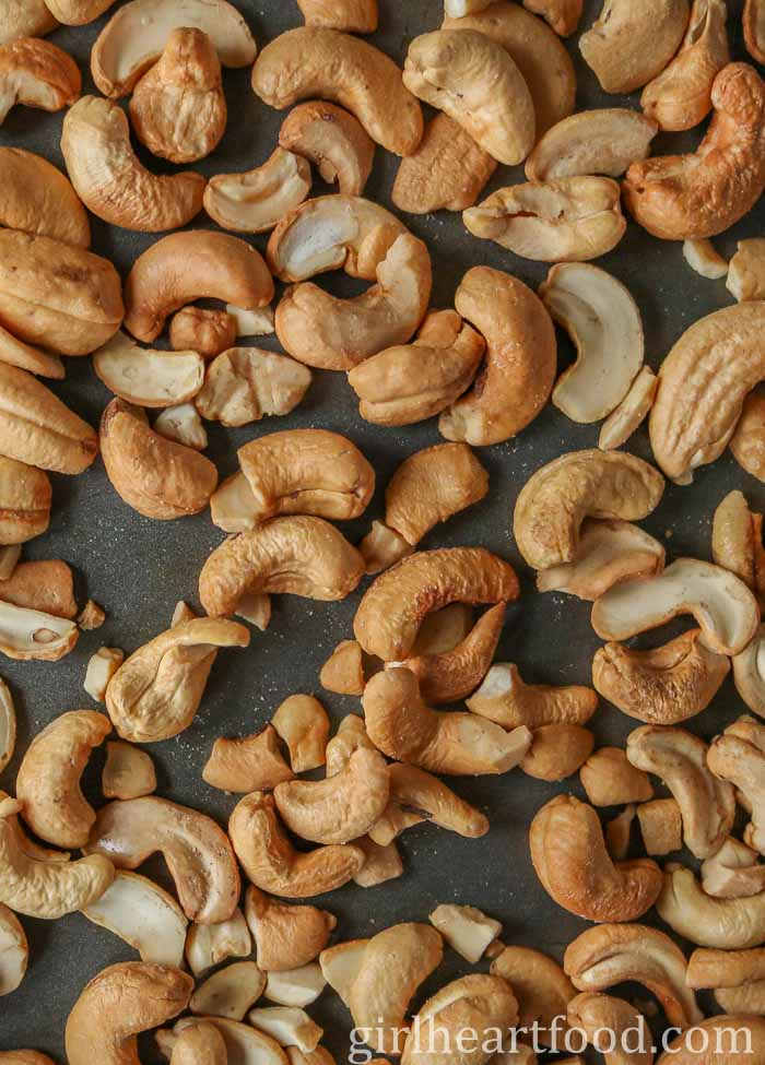 Roasted cashews on a sheet pan.