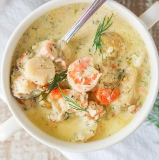 Bowl of creamy seafood chowder with dill.