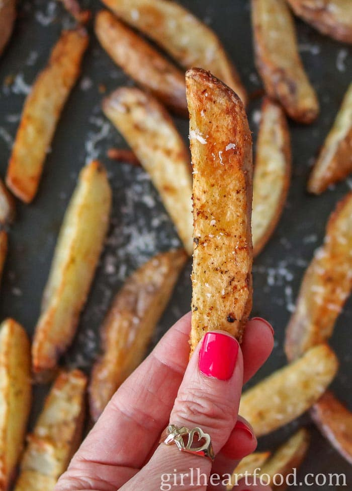 Hand holding a wedge fry.