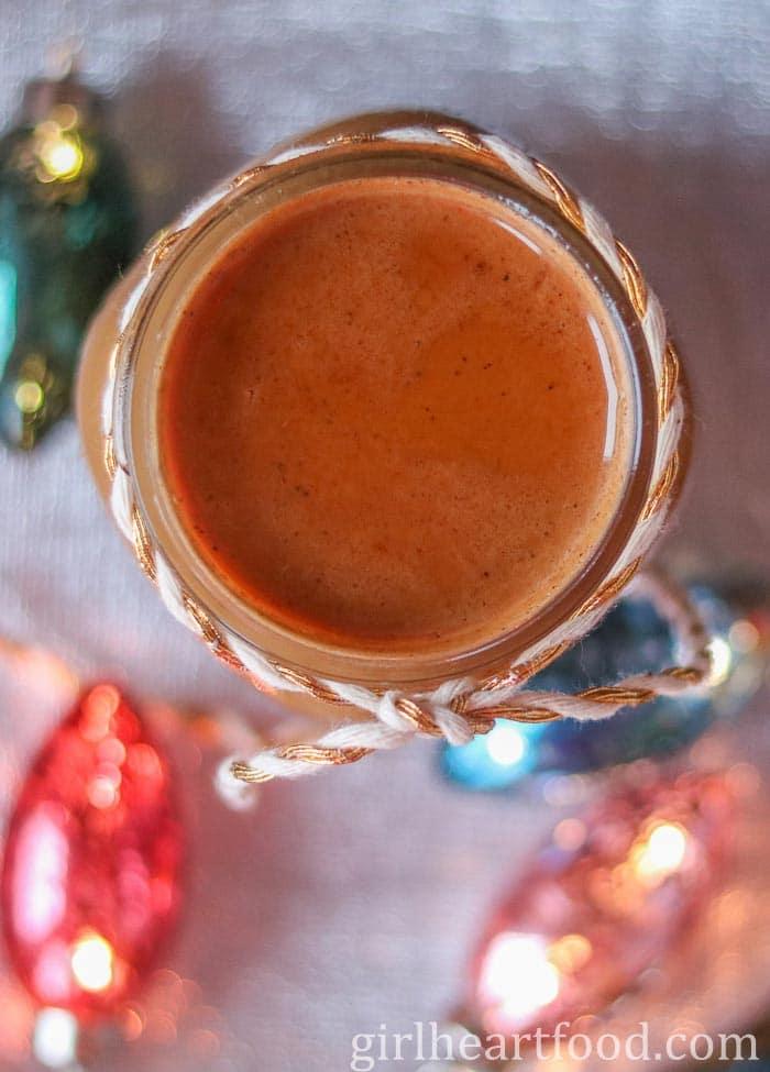 Overhead shot of a jar of flavoured creamer alongside some holiday lights.