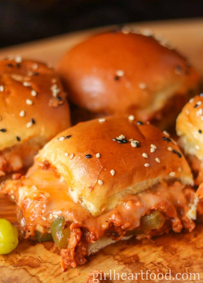 Sloppy joe sliders on a wooden board.