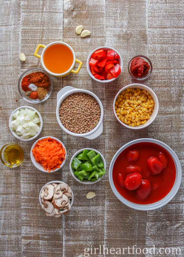 Ingredients for an easy vegan chili recipe on a wooden board.