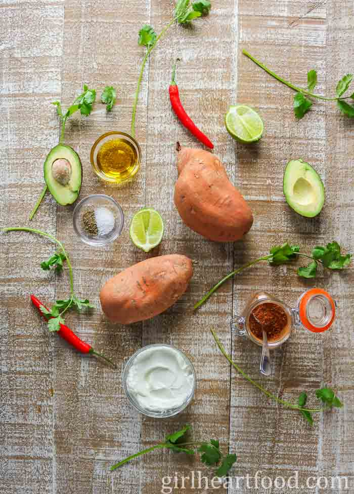 Ingredients for an easy sweet potato recipe with taco seasoning and avocado sauce.
